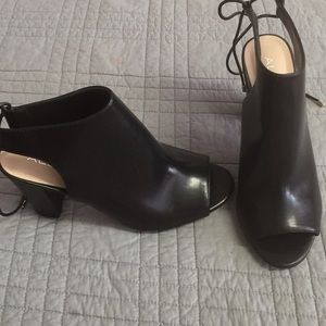 Like new!  ALDO back lacing, peep toe booties